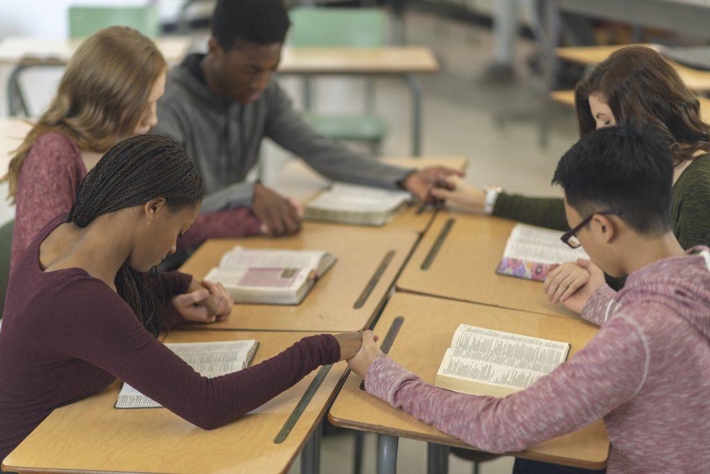 Five students praying